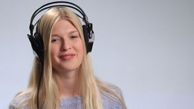 Beautiful woman listening to music in headphones stock video footage
