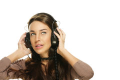 Beautiful woman listening to music looking up Royalty Free Stock Images