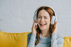 Beautiful woman listening to music and singing Royalty Free Stock Photography