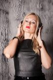 Beautiful woman listening to music Royalty Free Stock Image