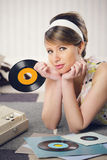 A woman listening to a record Stock Photography