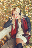 Beautiful woman listens to the music through a digital tablet Stock Photos