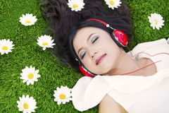 Beautiful woman listens to music outdoor Royalty Free Stock Photo