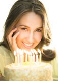 Beautiful Woman With Lit Candles On Cake Stock Photography