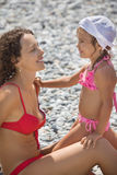 Beautiful woman with little girl on beach Stock Photography