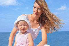 Beautiful woman with little girl near sea Stock Photography