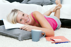 Beautiful woman in the living room taking notes. Royalty Free Stock Photography