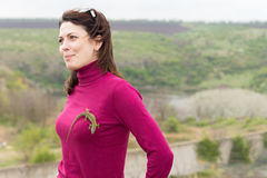 Beautiful woman with a lizard on her breast Royalty Free Stock Photo