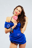 Beautiful woman with a lollipop Stock Images