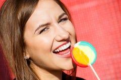 Beautiful woman with lollipop Stock Photo