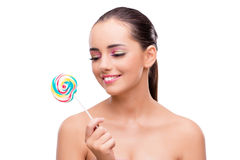 The beautiful woman with lollipop isolated on white Stock Images