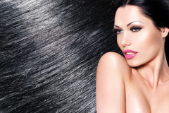 Beautiful woman with long black hair stock photo
