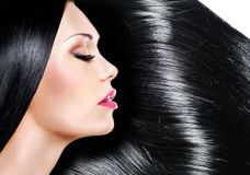 Beautiful woman with long black hair royalty free stock photo