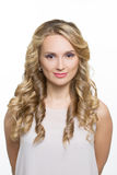 Beautiful woman with long blond curly hair Stock Images