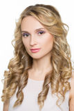Beautiful woman with long blond curly hair Royalty Free Stock Images