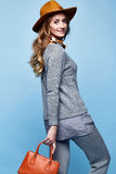 Beautiful woman long blond curly hair wear cashmere wool suit kn Royalty Free Stock Photos