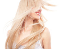 Beautiful woman with long blond hair. Portrait of beautiful woman with long blond hair over white royalty free stock photography