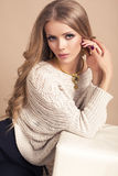 Beautiful woman with long blond hair  in beige sweater Stock Photos
