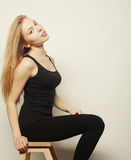 Beautiful woman with long blond hair. Fashion model posing at st Royalty Free Stock Photos