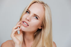 Beautiful woman with long blond hair and fresh skin Stock Photos