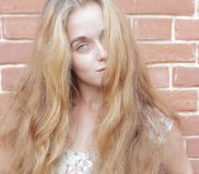 Beautiful woman with long blond hairs Royalty Free Stock Photo