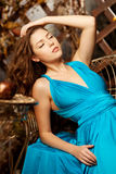 Beautiful woman in a long blue dress. Young girl in luxury fashi Royalty Free Stock Photography