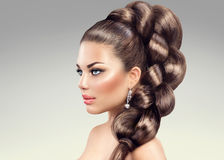 Beautiful woman with long braid Stock Image