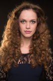 Beautiful woman with long brown curly hair Royalty Free Stock Photo