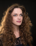 Beautiful woman with long brown curly hair Royalty Free Stock Images