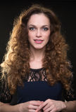 Beautiful woman with long brown curly hair Royalty Free Stock Photos