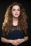 Beautiful woman with long brown curly hair Stock Image