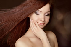 Beautiful woman with long brown hair. Royalty Free Stock Photos