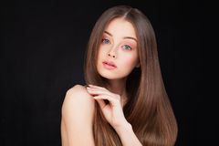 Beautiful Woman with Long Brown Hair. On Black Background Stock Image