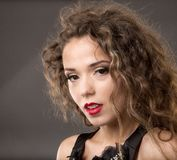 Beautiful woman with long brown hair. Closeup portrait of a fash Royalty Free Stock Photos