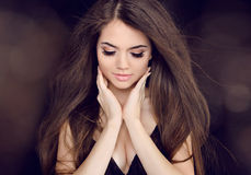 Beautiful woman with long brown hair. Fashion long hairstyles Stock Photo