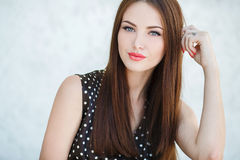 Beautiful woman with long brown hair. Stock Photo