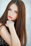 Beautiful woman with long brown hair. Glamour portrait of beautiful woman model with fresh daily makeup and romantic wavy hairstyle. Fashion shiny highlighter Royalty Free Stock Image
