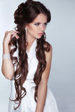 Beautiful woman with long brown hair wearing in white dress isol Stock Photography