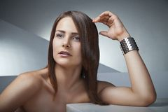 Beautiful woman with long brown straight hairs Royalty Free Stock Image