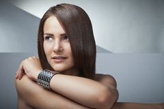 Beautiful woman with long brown straight hairs Stock Image
