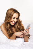 Woman with a joyful smile reading a text message Royalty Free Stock Photo