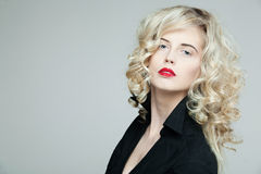 Beautiful woman with long curly blond hair. Stock Photos