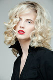 Beautiful woman with long curly blond hair. Royalty Free Stock Images