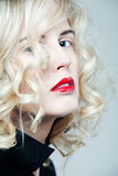 Beautiful woman with long curly blond hair. Stock Images
