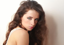 Beautiful woman with long curly brown hair Royalty Free Stock Photos
