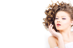 Beautiful woman with long curly hair Royalty Free Stock Images