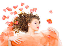 Beautiful woman with long curly hair Stock Images