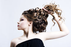 Beautiful woman with long curly hair Royalty Free Stock Image