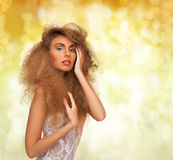 Beautiful woman with long curly hair Stock Photography