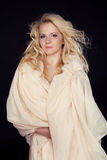Beautiful woman with long curly hair and fabric scarf isolated o Royalty Free Stock Image